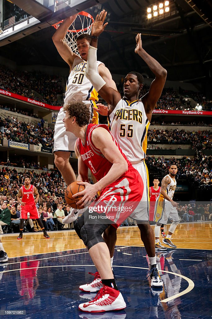 Omer Asik #3 of the Houston Rockets drives to the basket against Tyler Hansbrough #50 and Roy Hibbert #55 of the Indiana Pacers of the Indiana Pacers of the Houston Rockets on January 18, 2013 at Bankers Life Fieldhouse in Indianapolis, Indiana.
