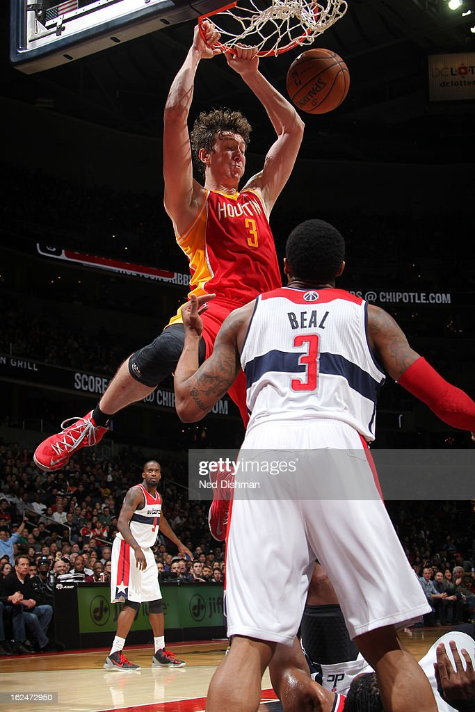 Omer Asik #3 of the Houston Rockets dunks against Bradley Beal #3 of the Washington Wizards during the game at the Verizon Center on February 23, 2013 in Washington, DC.