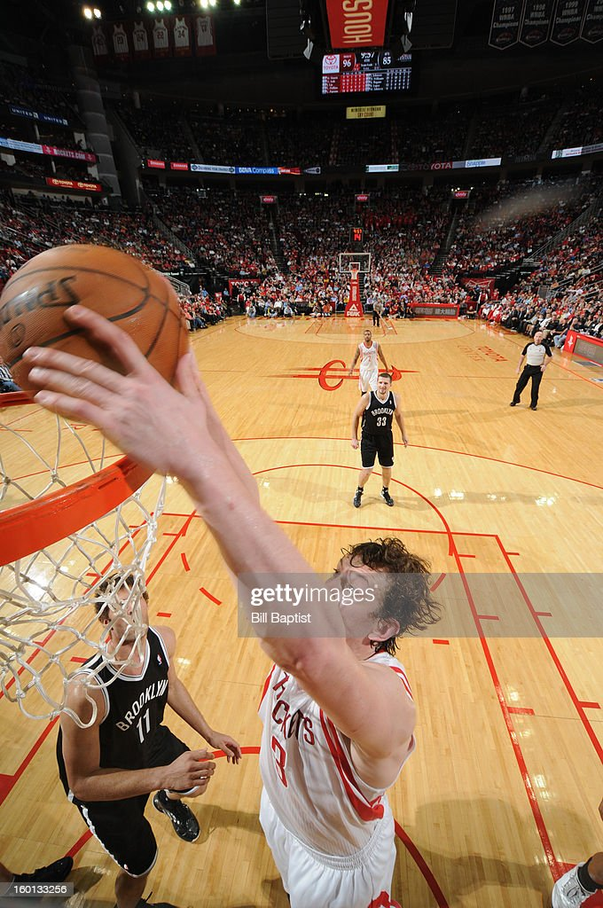 Omer Asik #3 of the Houston Rockets dunks against the Brooklyn Nets on January 26, 2013 at the Toyota Center in Houston, Texas.