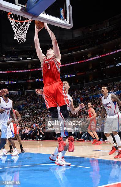 Omer Asik of the Houston Rockets dunks against the Los Angeles Clippers at Staples Center on February 26 2014 in Los Angeles California NOTE TO USER...