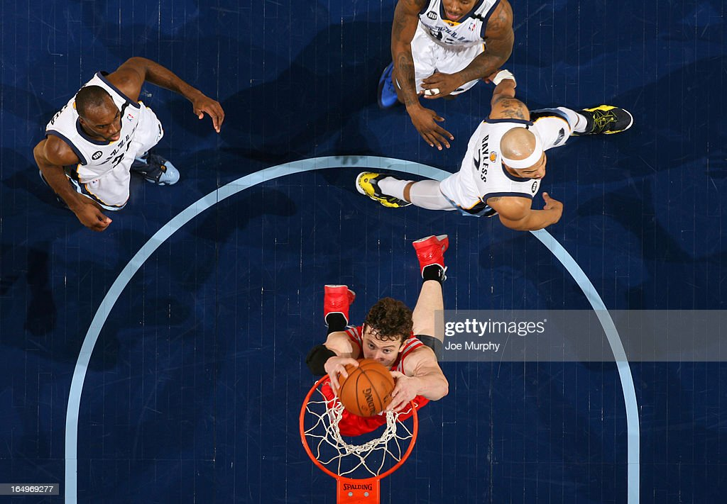 Omer Asik #3 of the Houston Rockets dunks against the Memphis Grizzlies on March 29, 2013 at FedExForum in Memphis, Tennessee.