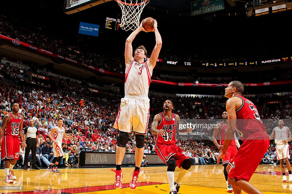 Omer Asik #3 of the Houston Rockets dunks against the Miami Heat on February 6, 2013 at American Airlines Arena in Miami, Florida.