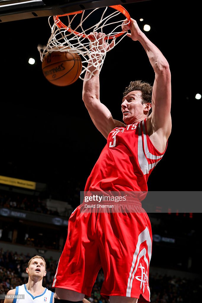 Omer Asik #3 of the Houston Rockets dunks against the Minnesota Timberwolves on December 26, 2012 at Target Center in Minneapolis, Minnesota.
