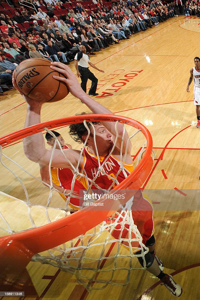 Omer Asik #3 of the Houston Rockets dunks the ball against the Atlanta Hawks on December 31, 2012 at the Toyota Center in Houston, Texas.