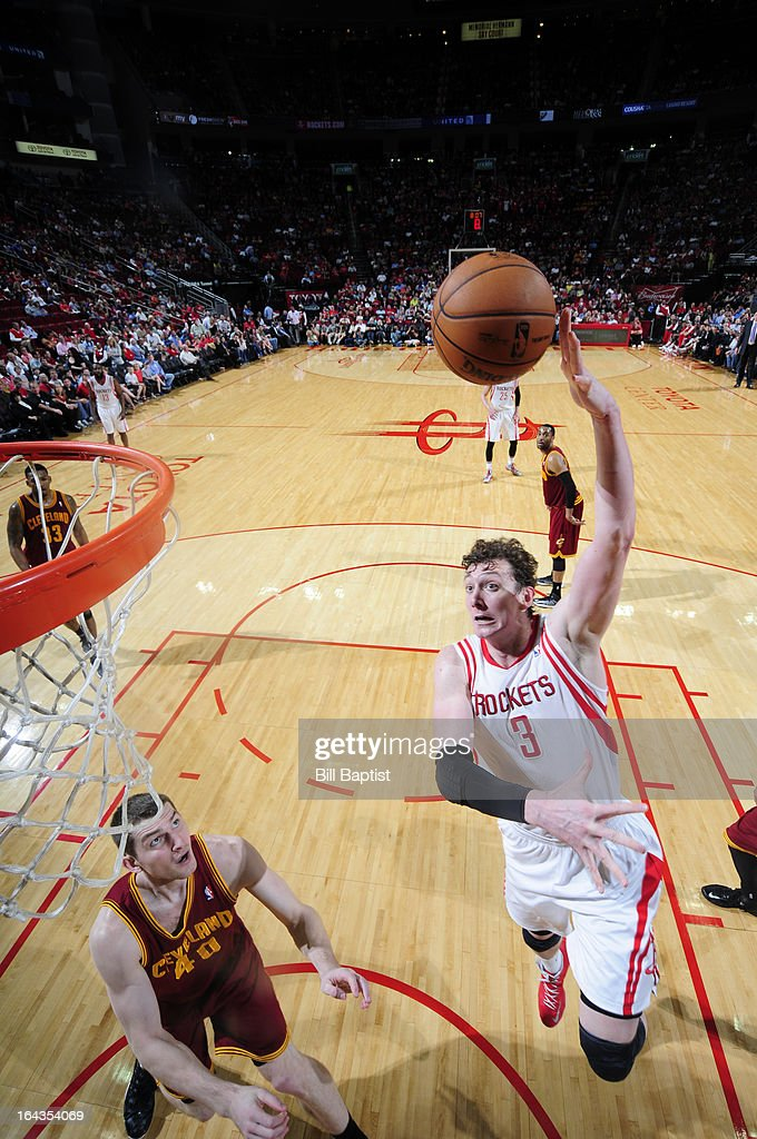 <a gi-track='captionPersonalityLinkClicked' href=/galleries/search?phrase=Omer+Asik&family=editorial&specificpeople=4946055 ng-click='$event.stopPropagation()'>Omer Asik</a> #3 of the Houston Rockets dunks the ball against <a gi-track='captionPersonalityLinkClicked' href=/galleries/search?phrase=Tyler+Zeller&family=editorial&specificpeople=5122156 ng-click='$event.stopPropagation()'>Tyler Zeller</a> #40 of the Cleveland Cavaliers on March 22, 2013 at the Toyota Center in Houston, Texas.