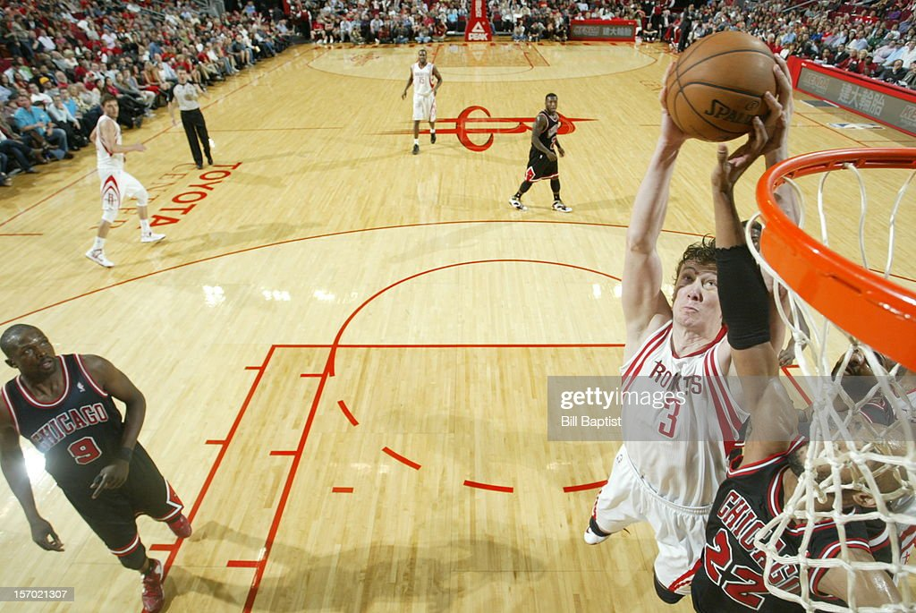 <a gi-track='captionPersonalityLinkClicked' href=/galleries/search?phrase=Omer+Asik&family=editorial&specificpeople=4946055 ng-click='$event.stopPropagation()'>Omer Asik</a> #3 of the Houston Rockets dunks the ball over <a gi-track='captionPersonalityLinkClicked' href=/galleries/search?phrase=Taj+Gibson&family=editorial&specificpeople=4029461 ng-click='$event.stopPropagation()'>Taj Gibson</a> #22 of the Chicago Bulls on November 21, 2012 at the Toyota Center in Houston, Texas.