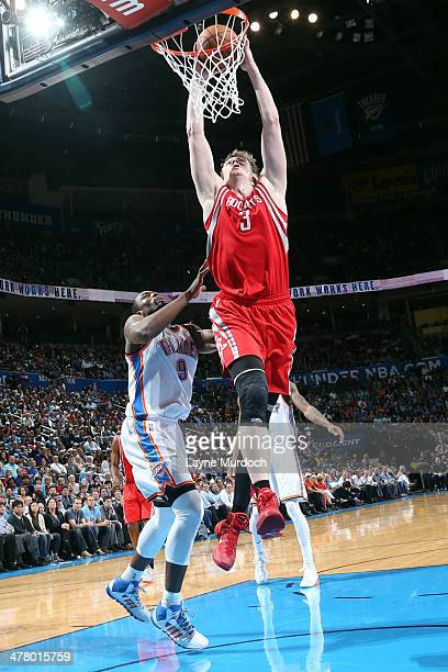 Omer Asik of the Houston Rockets goes up for the dunk against the Oklahoma City Thunder during an NBA game on March 11 2014 at the Chesapeake Energy...
