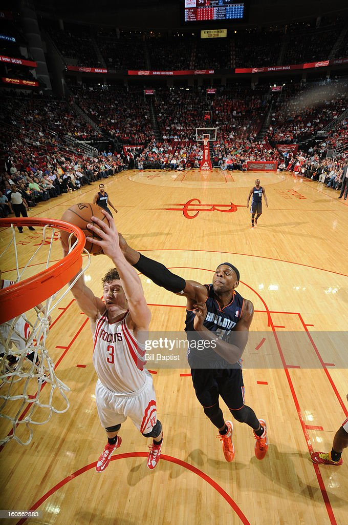 Omer Asik #3 of the Houston Rockets grabs a rebound against Brendan Haywood #33 of the Charlotte Bobcats on February 2, 2013 at the Toyota Center in Houston, Texas.