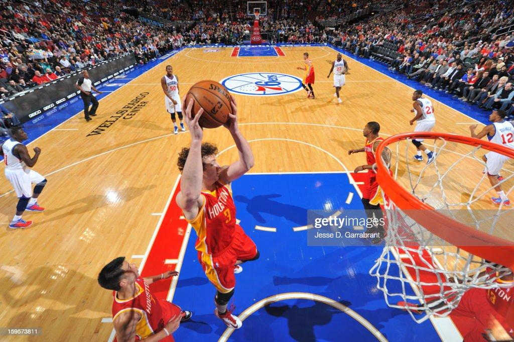 Omer Asik #3 of the Houston Rockets grabs a rebound against the Philadelphia 76ers at the Wells Fargo Center on January 12, 2013 in Philadelphia, Pennsylvania.