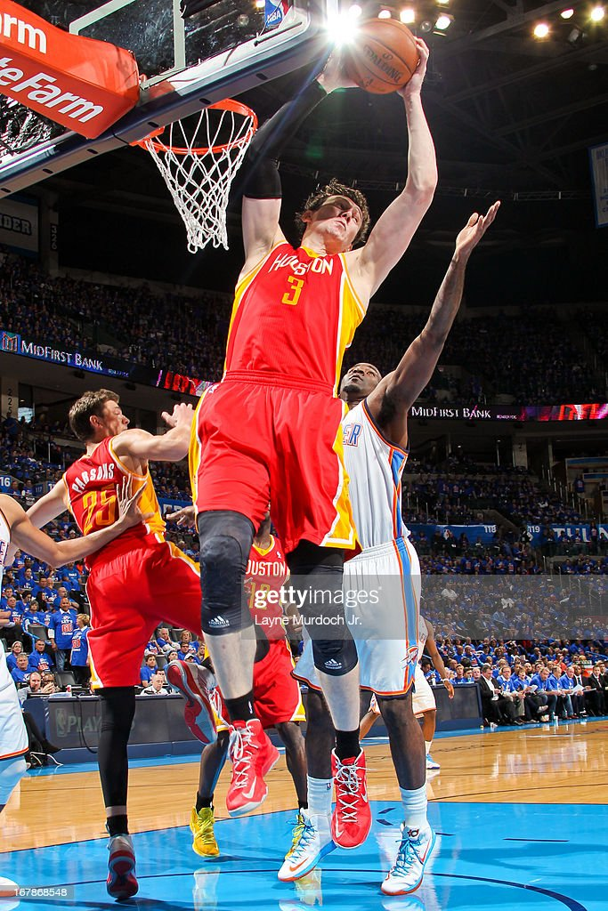 Omer Asik #3 of the Houston Rockets grabs a rebound against the Oklahoma City Thunder in Game Five of the Western Conference Quarterfinals during the 2013 NBA Playoffs on May 1, 2013 at the Chesapeake Energy Arena in Oklahoma City, Oklahoma.