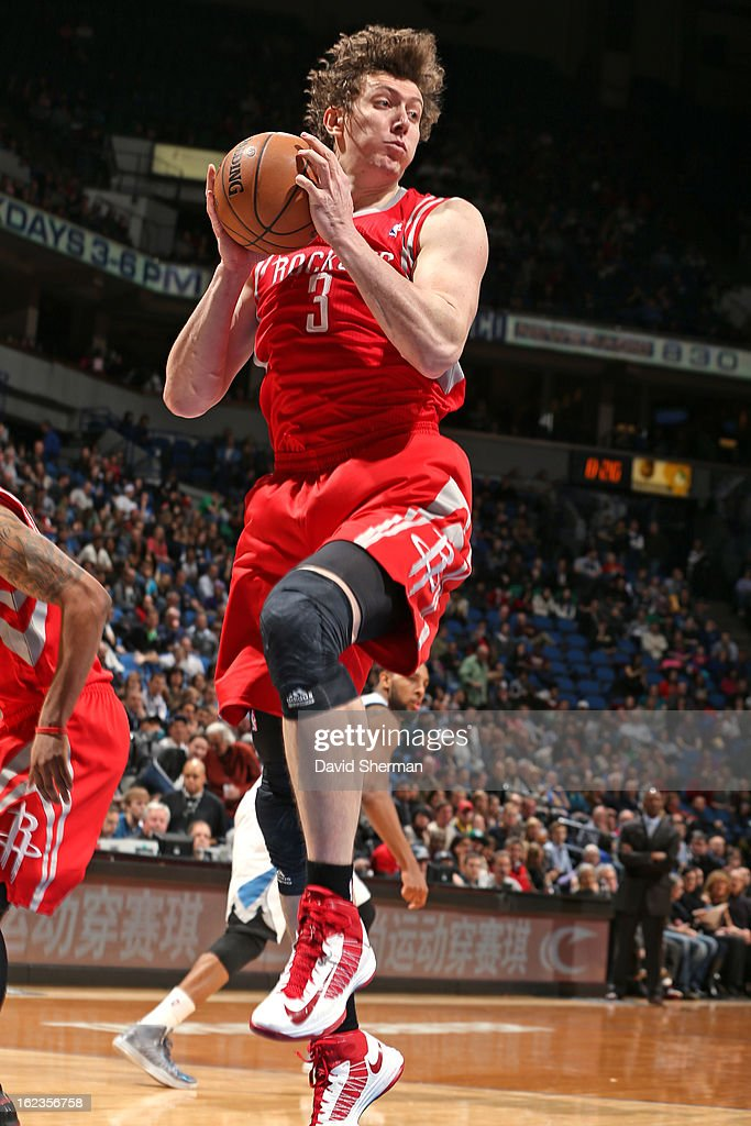 Omer Asik #3 of the Houston Rockets grabs a rebound against the Minnesota Timberwolves on January 19, 2013 at Target Center in Minneapolis, Minnesota.
