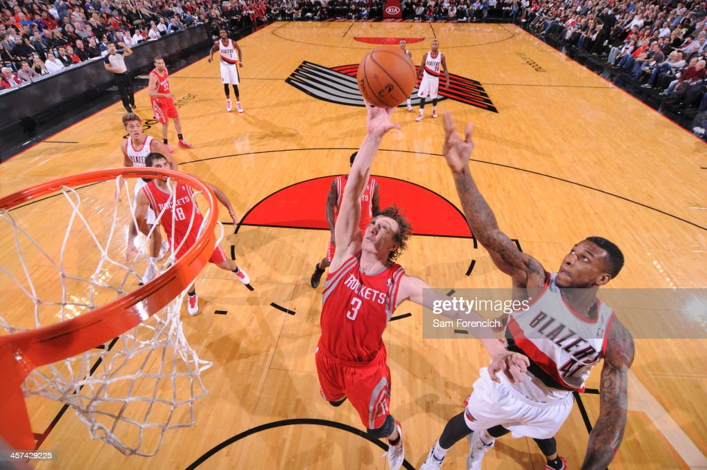 <a gi-track='captionPersonalityLinkClicked' href=/galleries/search?phrase=Omer+Asik&family=editorial&specificpeople=4946055 ng-click='$event.stopPropagation()'>Omer Asik</a> #3 of the Houston Rockets grabs a rebound against the Portland Trail Blazers on November 5, 2013 at the Moda Center Arena in Portland, Oregon.