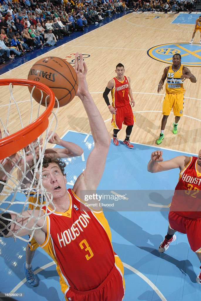 Omer Asik #3 of the Houston Rockets grabs the ball in mid-air against the Denver Nuggets on April 6, 2013 at the Pepsi Center in Denver, Colorado.