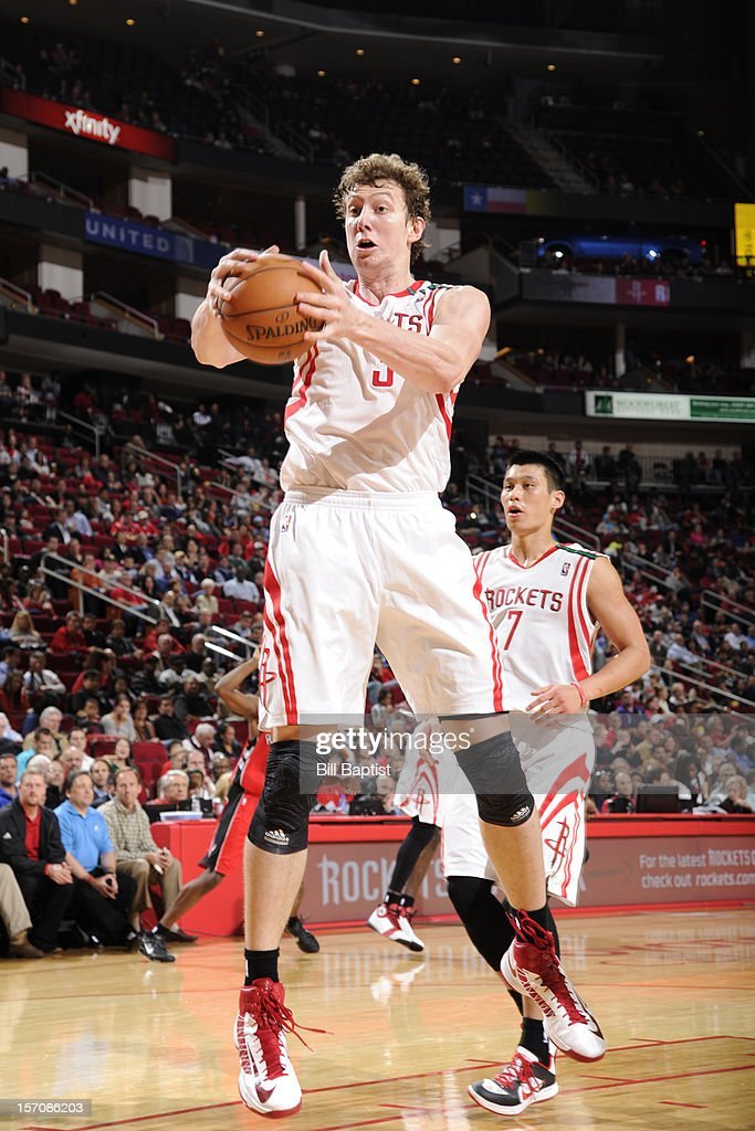 <a gi-track='captionPersonalityLinkClicked' href=/galleries/search?phrase=Omer+Asik&family=editorial&specificpeople=4946055 ng-click='$event.stopPropagation()'>Omer Asik</a> #3 of the Houston Rockets grabs the rebound against the Toronto Raptors on November 27, 2012 at the Toyota Center in Houston, Texas.