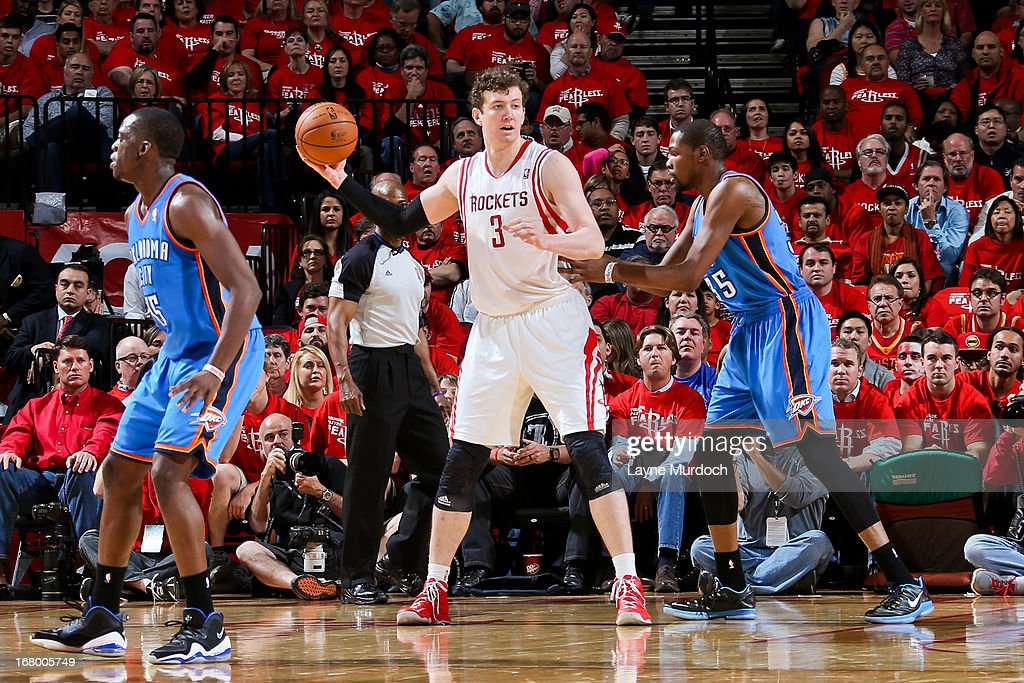Omer Asik #3 of the Houston Rockets looks to pass the ball against Kevin Durant #35 of the Oklahoma City Thunder in Game Six of the Western Conference Quarterfinals during the 2013 NBA Playoffs on May 3, 2013 at the Toyota Center in Houston, Texas.