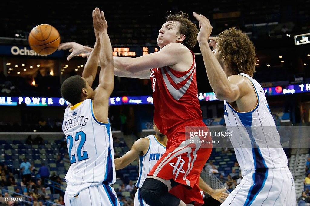 <a gi-track='captionPersonalityLinkClicked' href=/galleries/search?phrase=Omer+Asik&family=editorial&specificpeople=4946055 ng-click='$event.stopPropagation()'>Omer Asik</a> #3 of the Houston Rockets passes the ball around Brian Roberts #22 of the New Orleans Hornets at New Orleans Arena on October 24, 2012 in New Orleans, Louisiana.