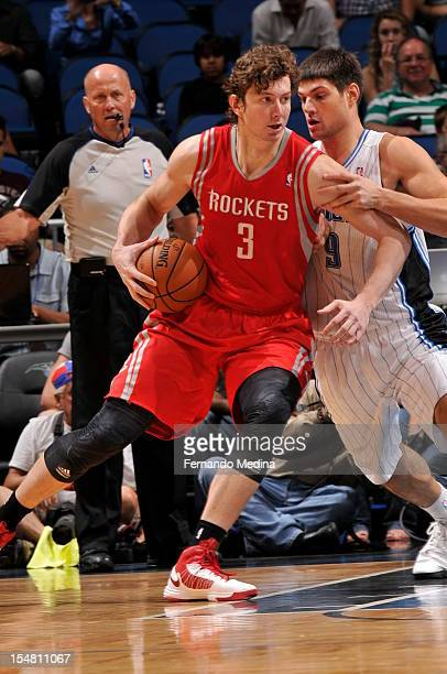 Omer Asik of the Houston Rockets protects the ball from Nikola Vucevic of the Orlando Magic during the game between the Houston Rockets and the...