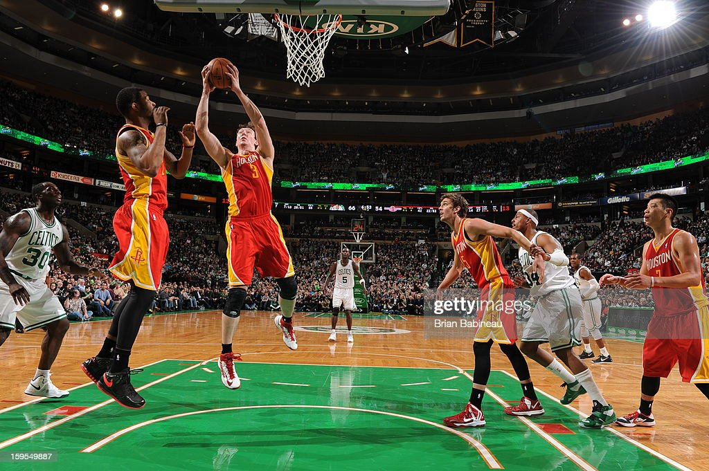 Omer Asik #3 of the Houston Rockets pulls down a rebound against the Boston Celtics on January 11, 2013 at the TD Garden in Boston, Massachusetts.