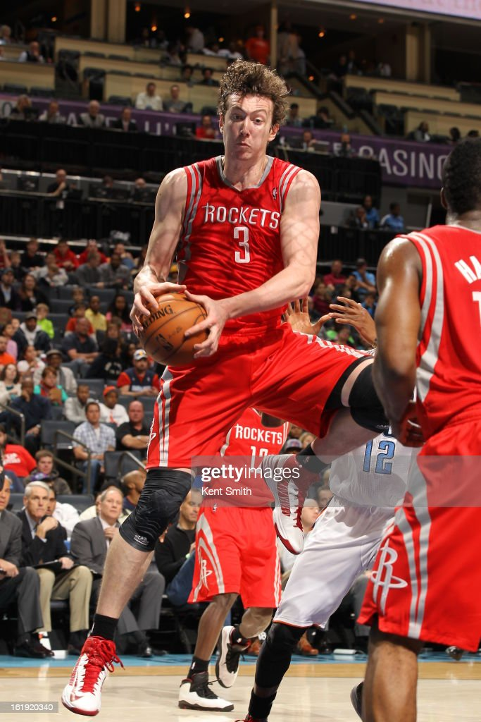 Omer Asik #3 of the Houston Rockets rebounds against the Charlotte Bobcats at the Time Warner Cable Arena on January 21, 2013 in Charlotte, North Carolina.