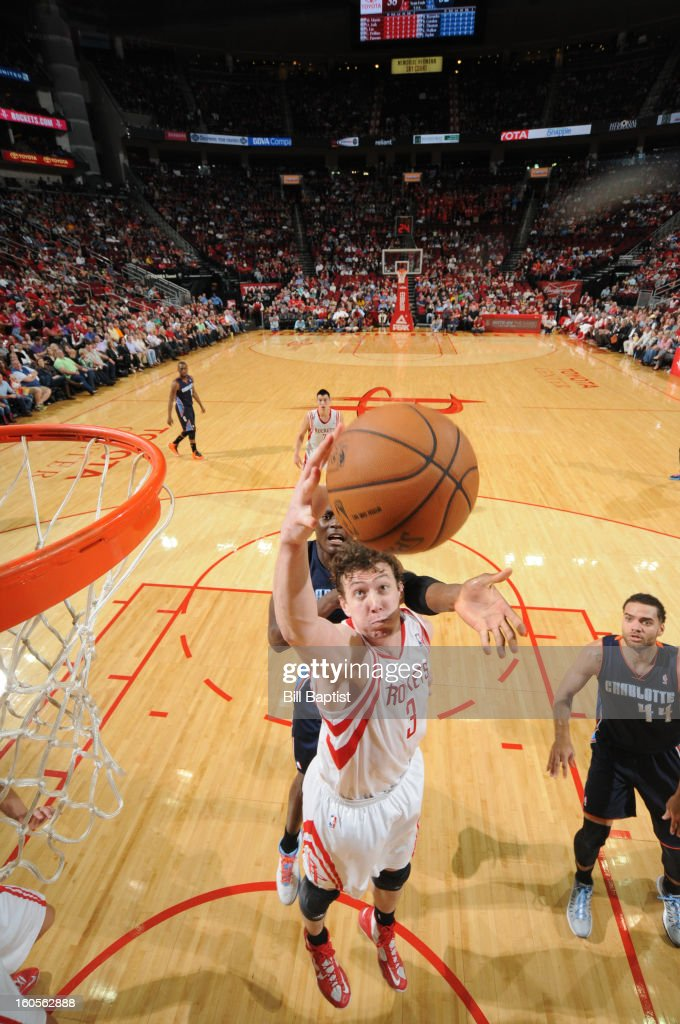 Omer Asik #3 of the Houston Rockets rebounds against the Charlotte Bobcats on February 2, 2013 at the Toyota Center in Houston, Texas.