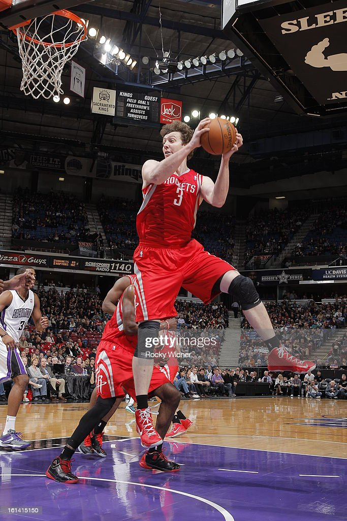 Omer Asik #3 of the Houston Rockets rebounds the ball against the Sacramento Kings on February 10, 2013 at Sleep Train Arena in Sacramento, California.