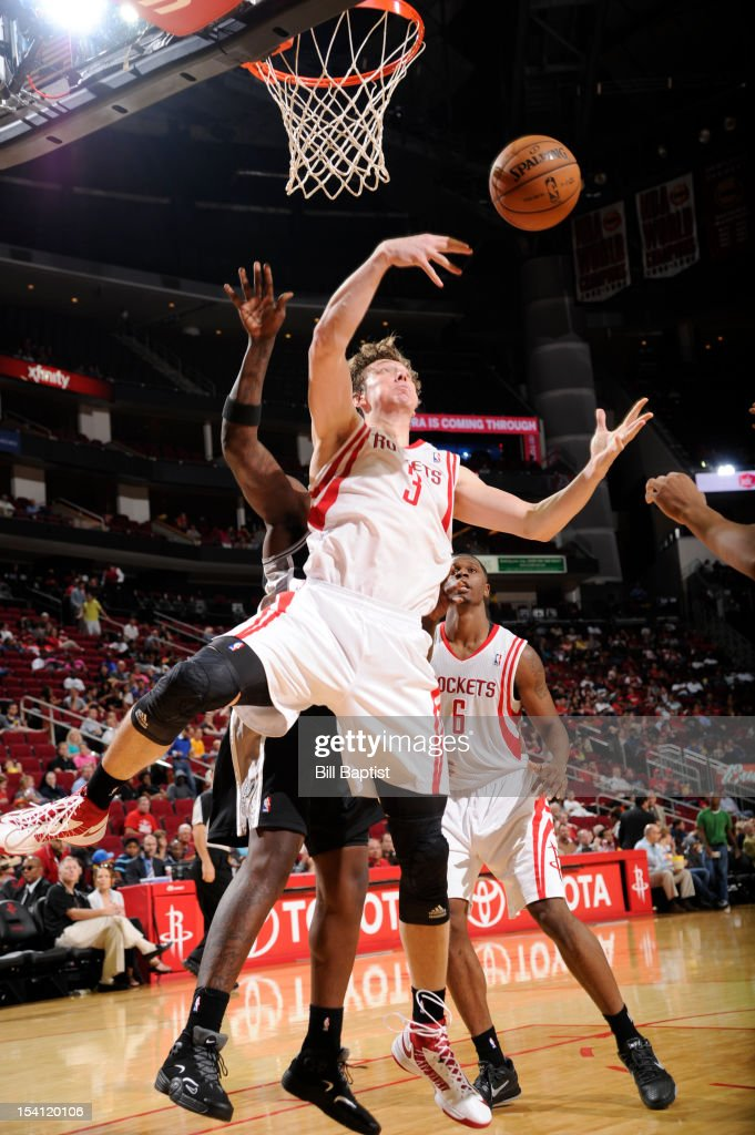 <a gi-track='captionPersonalityLinkClicked' href=/galleries/search?phrase=Omer+Asik&family=editorial&specificpeople=4946055 ng-click='$event.stopPropagation()'>Omer Asik</a> #3 of the Houston Rockets rebounds the ball against the San Antonio Spurs during a pre-season game on October 14, 2012 at the Toyota Center in Houston, Texas.