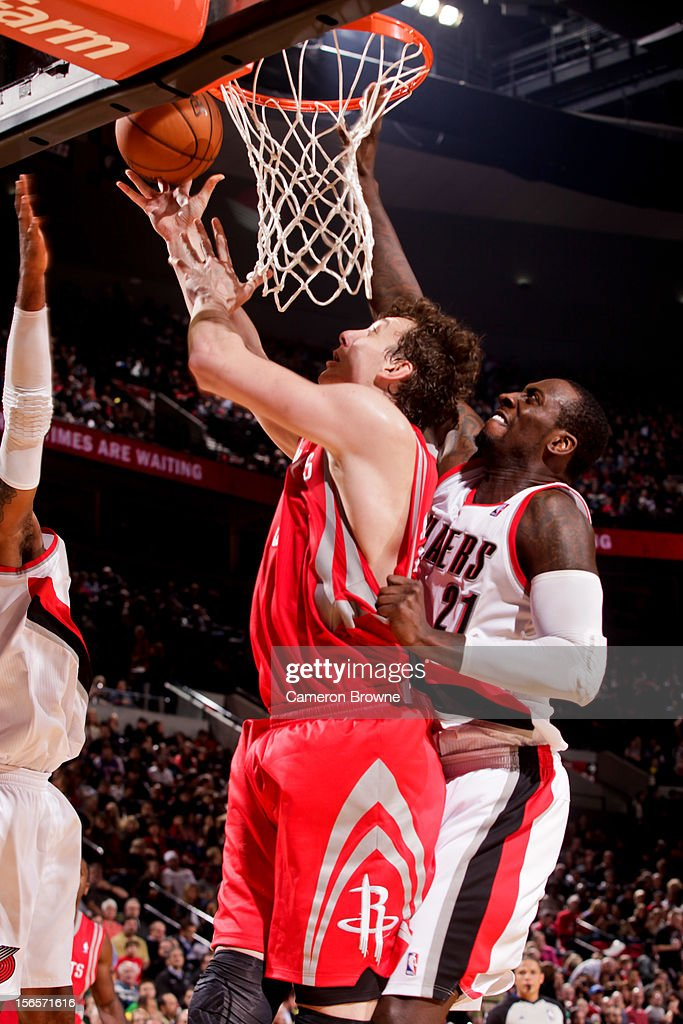 <a gi-track='captionPersonalityLinkClicked' href=/galleries/search?phrase=Omer+Asik&family=editorial&specificpeople=4946055 ng-click='$event.stopPropagation()'>Omer Asik</a> #3 of the Houston Rockets shoots a layup against <a gi-track='captionPersonalityLinkClicked' href=/galleries/search?phrase=J.J.+Hickson&family=editorial&specificpeople=4226173 ng-click='$event.stopPropagation()'>J.J. Hickson</a> #21 of the Portland Trail Blazers on November 16, 2012 at the Rose Garden Arena in Portland, Oregon.