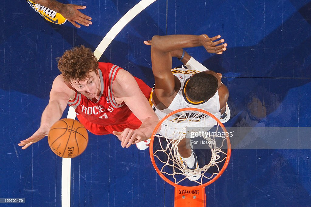 Omer Asik #3 of the Houston Rockets shoots a layup against <a gi-track='captionPersonalityLinkClicked' href=/galleries/search?phrase=Roy+Hibbert&family=editorial&specificpeople=725128 ng-click='$event.stopPropagation()'>Roy Hibbert</a> #55 of the Indiana Pacers on January 18, 2013 at Bankers Life Fieldhouse in Indianapolis, Indiana.