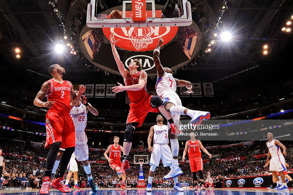 Omer Asik #3 of the Houston Rockets shoots a reverse layup against Lamar Odom #7 of the Los Angeles Clippers at Staples Center on February 13, 2013 in Los Angeles, California.