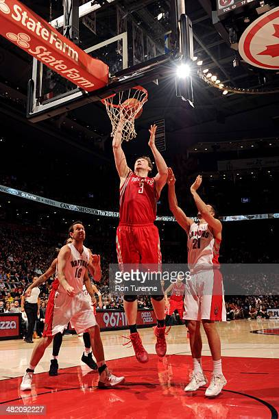Omer Asik of the Houston Rockets shoots against the Toronto Raptors on April 2 2014 at the Air Canada Centre in Toronto Ontario Canada NOTE TO USER...