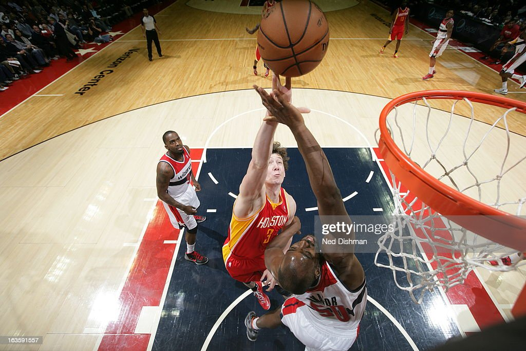 <a gi-track='captionPersonalityLinkClicked' href=/galleries/search?phrase=Omer+Asik&family=editorial&specificpeople=4946055 ng-click='$event.stopPropagation()'>Omer Asik</a> #3 of the Houston Rockets shoots against the Washington Wizards during the game at the Verizon Center on February 23, 2013 in Washington, DC.