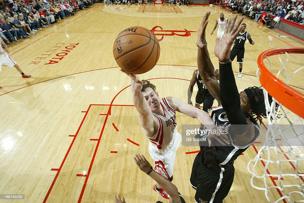 Omer Asik #3 of the Houston Rockets shoots the ball against Gerald Wallace #45 of the Brooklyn Nets on January 26, 2013 at the Toyota Center in Houston, Texas.
