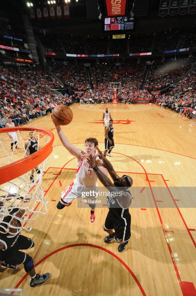 Omer Asik #3 of the Houston Rockets shoots the ball against Reggie Evans #30 of the Brooklyn Nets on January 26, 2013 at the Toyota Center in Houston, Texas.