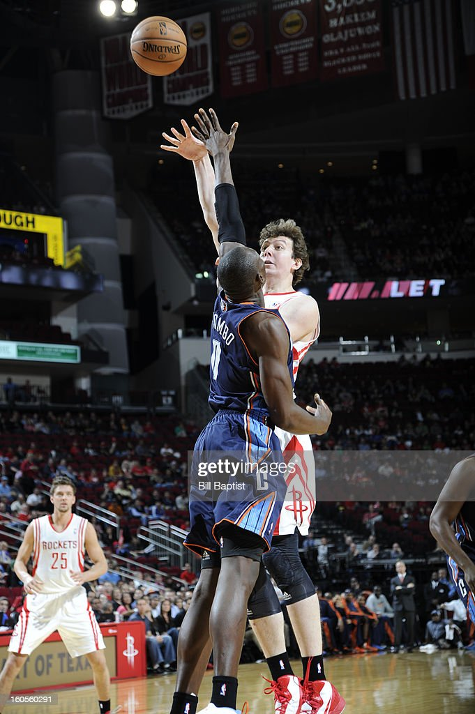 Omer Asik #3 of the Houston Rockets shoots the ball over Bismack Biyombo #0 of the Charlotte Bobcats on February 2, 2013 at the Toyota Center in Houston, Texas.