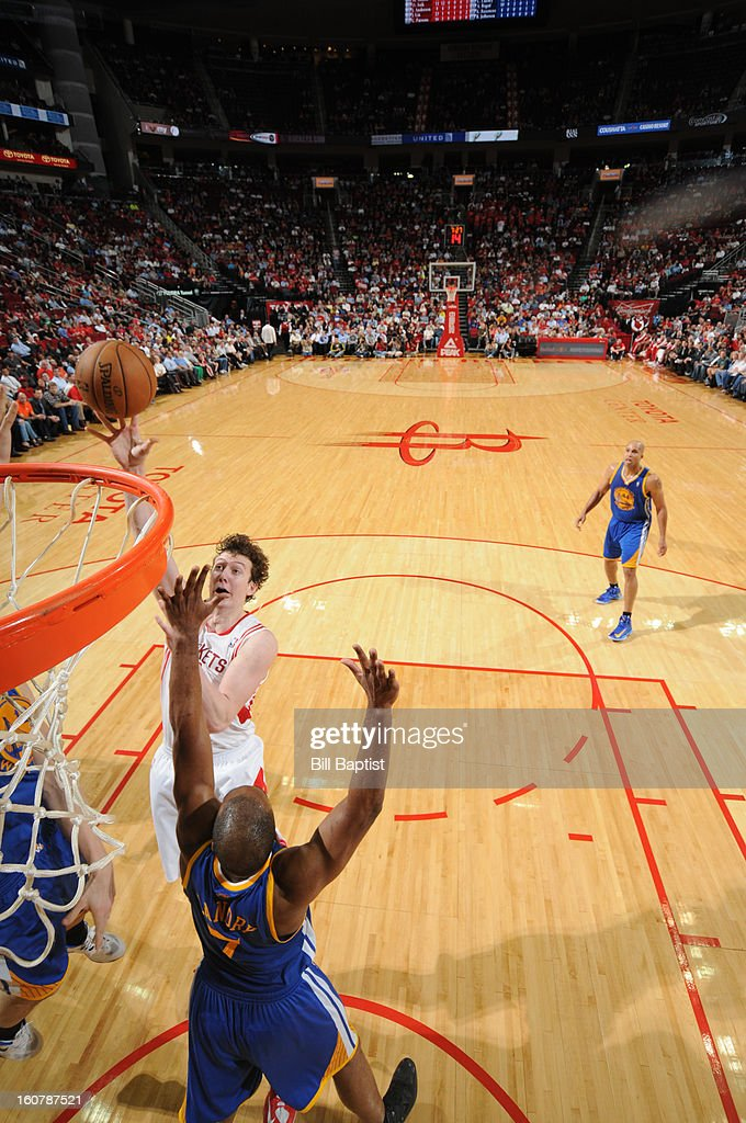 Omer Asik #3 of the Houston Rockets shoots the ball over Carl Landry #7 of the Golden State Warriors on February 5, 2013 at the Toyota Center in Houston, Texas.