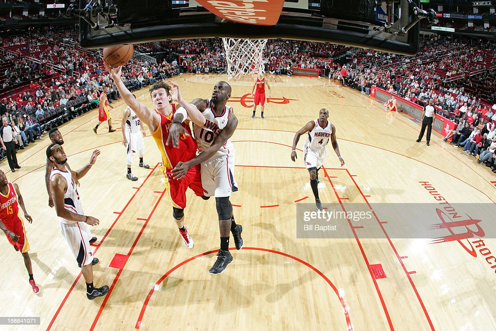 Omer Asik #3 of the Houston Rockets shoots the ball over <a gi-track='captionPersonalityLinkClicked' href=/galleries/search?phrase=Johan+Petro&family=editorial&specificpeople=564344 ng-click='$event.stopPropagation()'>Johan Petro</a> #10 of the Atlanta Hawks on December 31, 2012 at the Toyota Center in Houston, Texas.