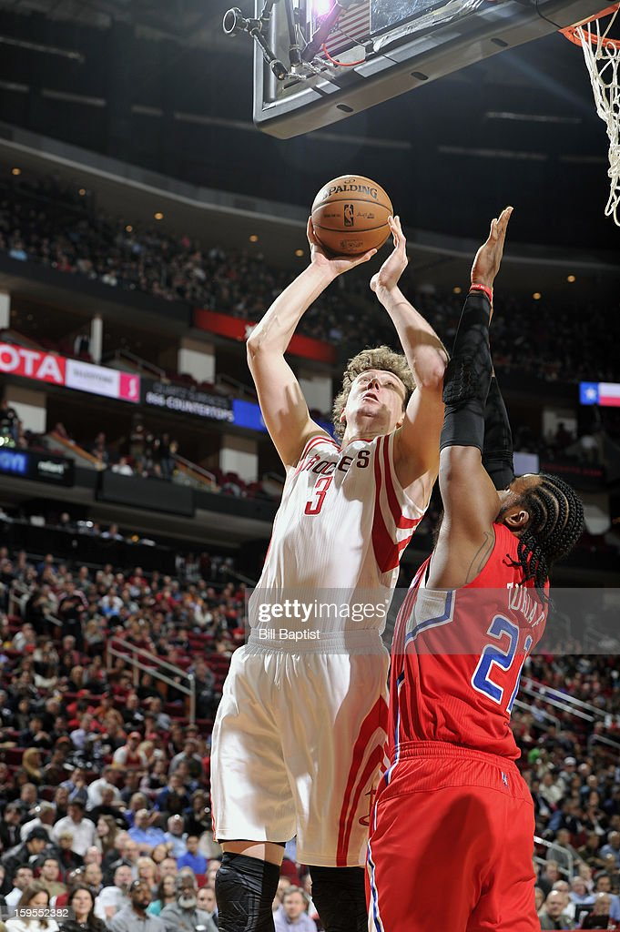 Omer Asik #3 of the Houston Rockets shoots the ball over Ronny Turiaf #21 of the Los Angeles Clippers on January 15, 2013 at the Toyota Center in Houston, Texas.