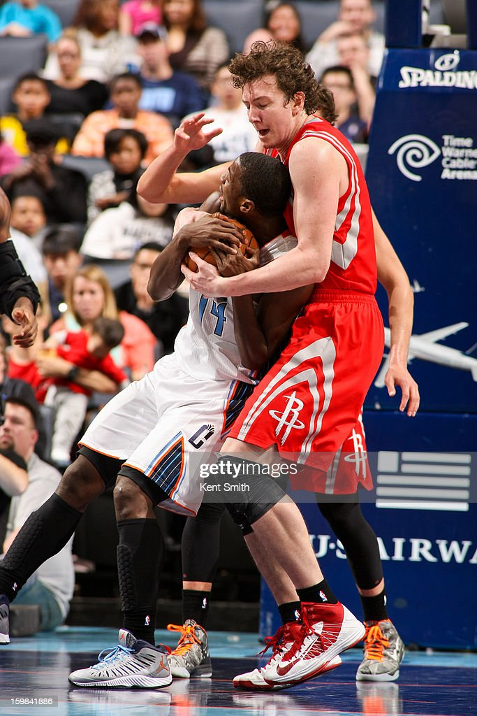 Omer Asik #3 of the Houston Rockets tries to steal the ball from Michael Kidd-Gilchrist #14 of the Charlotte Bobcats at the Time Warner Cable Arena on January 21, 2013 in Charlotte, North Carolina.