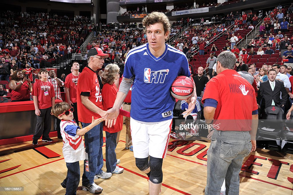 Omer Asik #3 of the Houston Rockets, wearing a NBA Fit week shirt, is announced before the game against the Brooklyn Nets on January 26, 2013 at the Toyota Center in Houston, Texas.