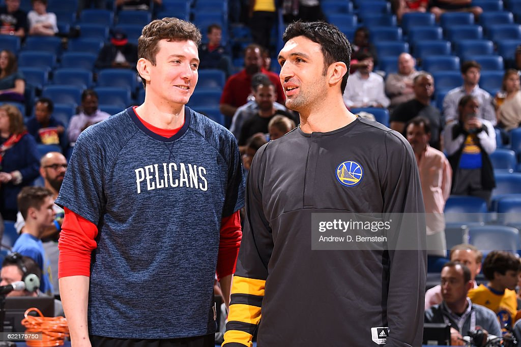 Omer Asik #3 of the New Orleans Pelicans and Zaza Pachulia #27 of the Golden State Warriors talk before a game at Smoothie King Center on October 28, 2016 in New Orleans, Louisiana.