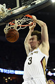 Omer Asik of the New Orleans Pelicans dunks against the Sacramento Kings during the first half of a game at the Smoothie King Center on January 28...