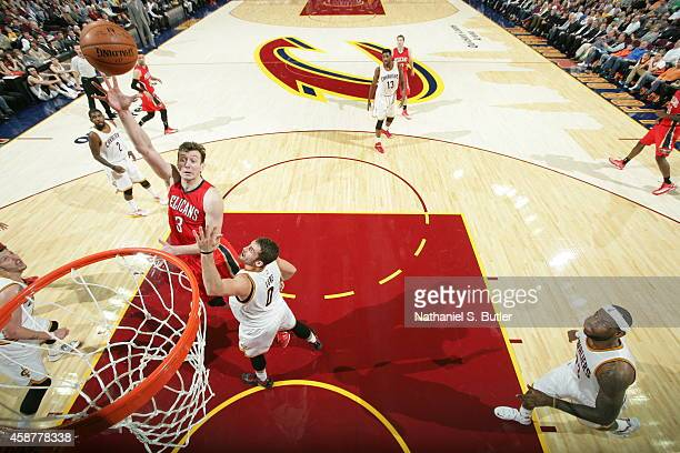 Omer Asik of the New Orleans Pelicans goes to the basket against the Cleveland Cavaliers on November 10 2014 at Quicken Loans Arena in Cleveland Ohio...