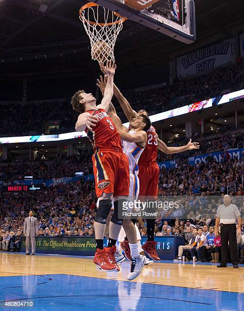 Omer Asik of the New Orleans Pelicans grabs a rebound against the Oklahoma City Thunder at the Chesapeake Energy Arena on December 21 2013 in...