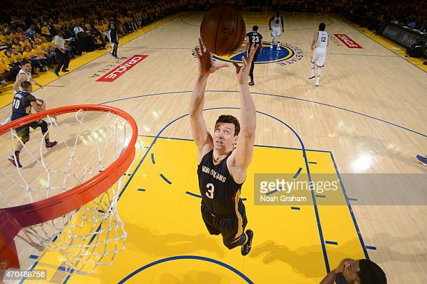 Omer Asik of the New Orleans Pelicans grabs a rebound against the Golden State Warriors in Game One of the Western Conference Quarterfinals during...
