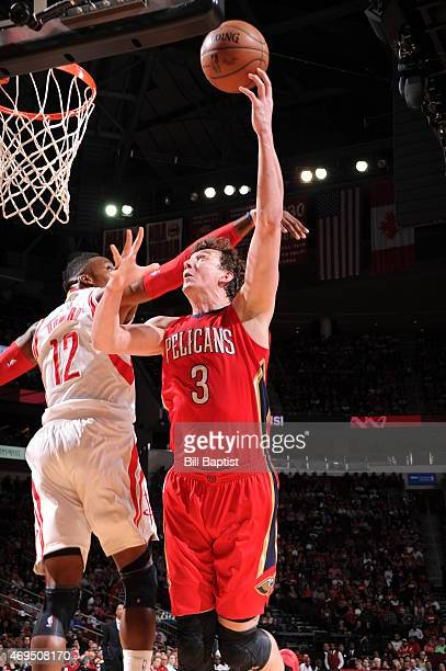 Omer Asik of the New Orleans Pelicans shoots against Dwight Howard of the Houston Rockets on April 12 2015 at the Toyota Center in Houston Texas NOTE...