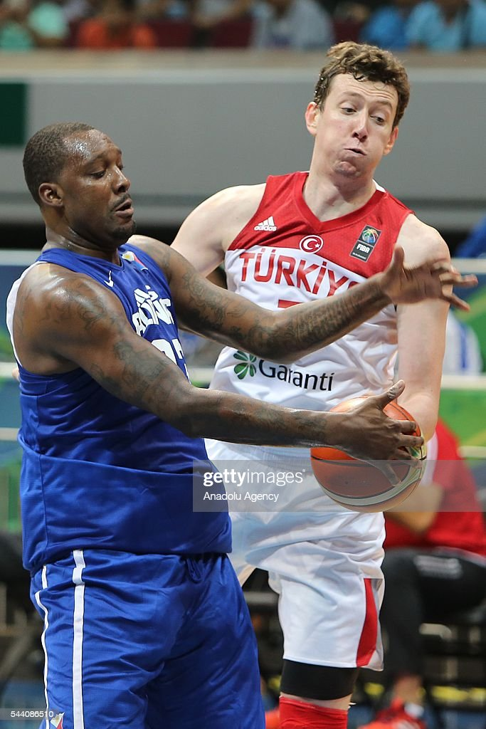 Omer Asik (R) of Turkey in action during a friendly match between Philippines and Turkey friendly match at Mall of Asia Arena (MOA) in Pasay, Philippines on July 01, 2016.