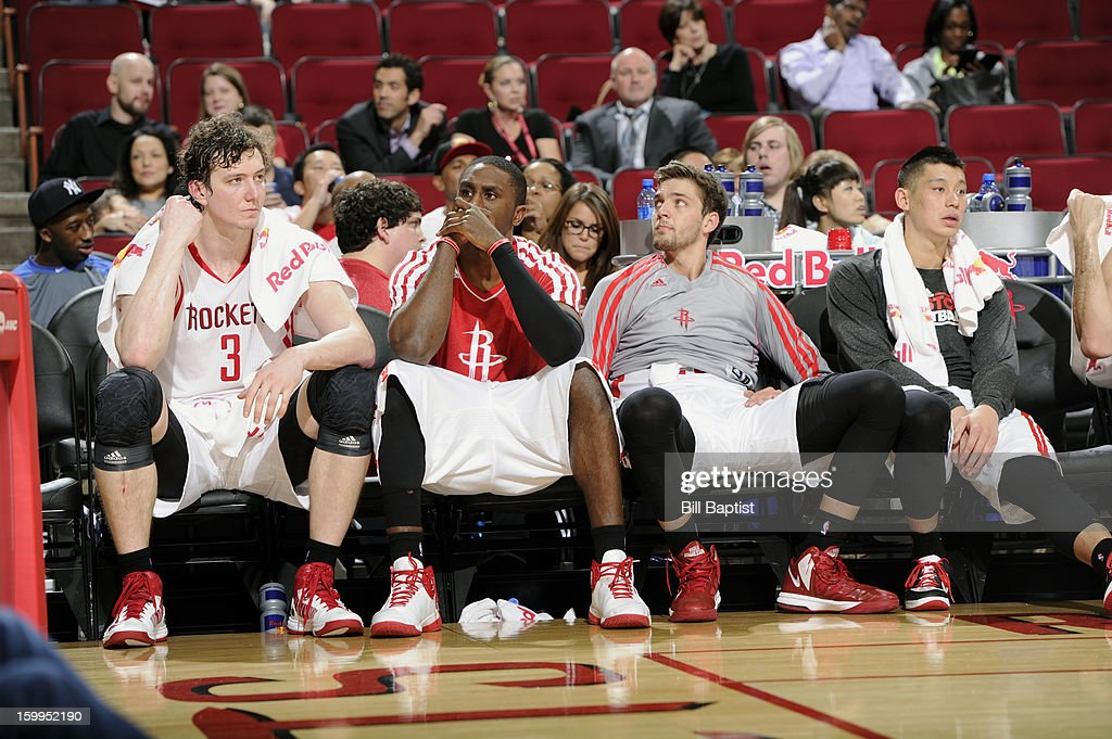 Omer Asik #3, Patrick Patterson #54, Chandler Parsons #25 and Jeremy Lin #7 of the Houston Rockets react to the loss against the Denver Nuggets on January 23, 2013 at the Toyota Center in Houston, Texas.