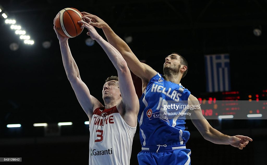 Omer Faruk Asik (3) of Turkey in action against Ioannis Papapetrou (19) of Greece during the friendly match at Abdi Ipekci Sports Hall in Istanbul, Turkey on June 26, 2016.