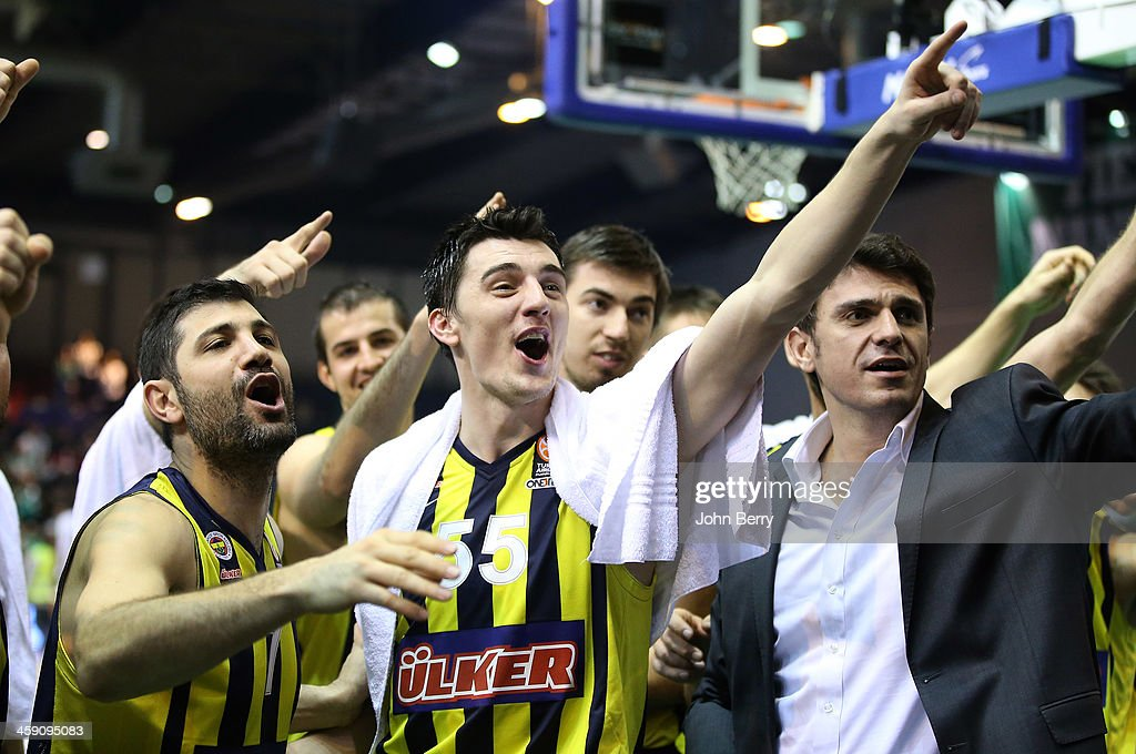 Omer Onan, Emir Preldzic of Fenerbahce celebrate the victory and thank their supporters after the Turkish Airlines Euroleague match between JSF Nanterre and Fenerbahce Ulker Istanbul at the Halle Carpentier on December 19, 2013 in Paris, France.