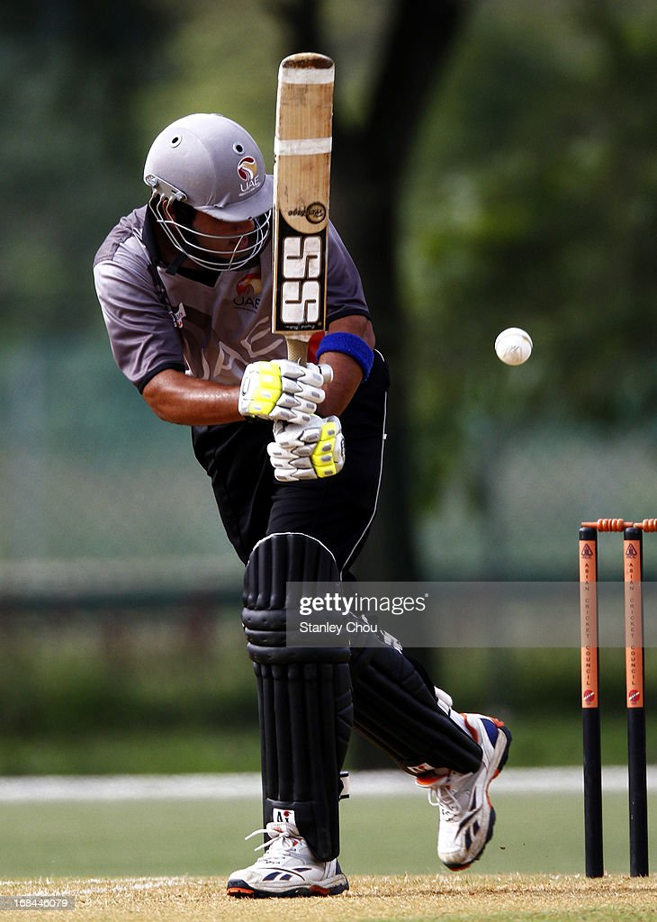 Omer Rizwan Mohammed of UAE hits a four during the ACC U-19 Elite Cup Semi Final against Nepal at the Bayuemas Cricket Ground on May 10, 2013 in Kuala Lumpur, Malaysia.